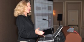 Linda Sherman presenting in black suit