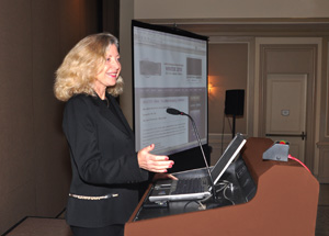 Linda Sherman presenting in black suit