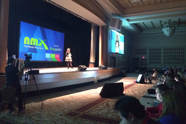 Lynette Young delivering opening keynote for NMX photo by Linda Sherman